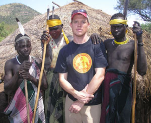 Rolf with Mursi tribesmen in the Omo Valley of Ethiopia, on assignment for the New York Times Magazine in August of 2008