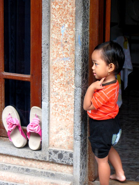 Balinese boy in doorway