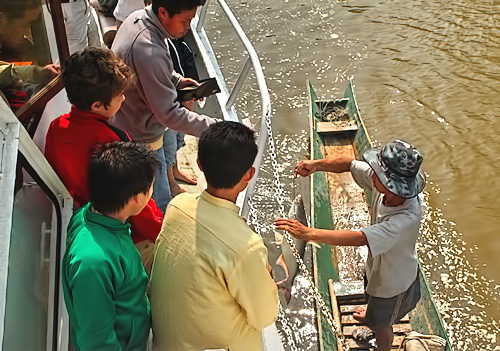 Buying fresh fish on the Mekong River