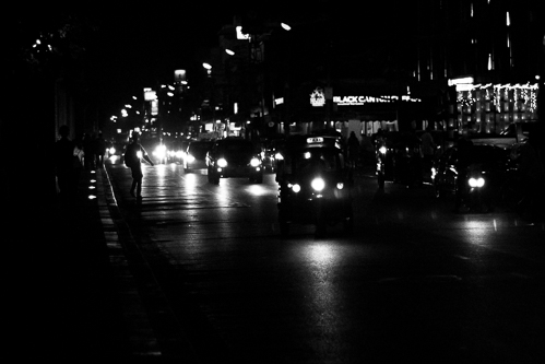 The road around the moat at night. A busy tree-lined street that is always full of motorbikes and tuk tuks.