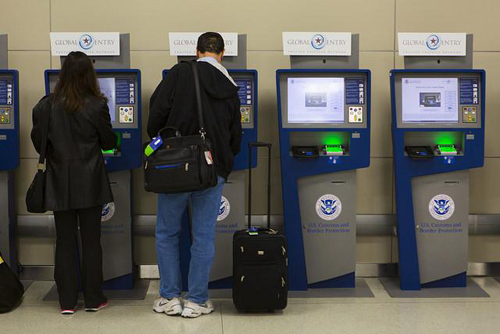 Using the Global Entry kiosks. Photos courtesy of GOES.